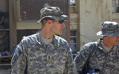 In this Sunday, Sept. 21, 2008, file photo, 1st Lt. Michael C. Behenna, left, and his defense attorney Capt. Tom Clark, right, walk in Camp Speicher, a large US base near Tikrit, north of Baghdad, Iraq (AP Photo/Vanessa Gera, File)