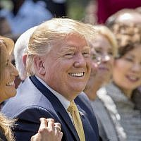 US President Donald Trump and First Lady Melania Trump, left, smile during a one year anniversary event for her Be Best initiative in the Rose Garden of the White House, May 7, 2019, in Washington. (AP Photo/Andrew Harnik)