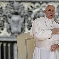 File: Pope Francis does the sign of the cross during his weekly general audience, in St. Peter's Square, at the Vatican, May 8, 2019. (AP Photo/Alessandra Tarantino)