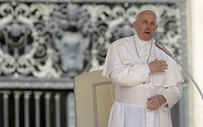 Pope Francis does the sign of the cross during his weekly general audience, in St. Peter's Square, at the Vatican, May 8, 2019. (AP Photo/Alessandra Tarantino)