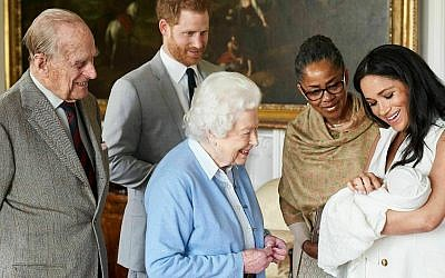 In this image made available by SussexRoyal on Wednesday May 8, 2019, Britain's Prince Harry and Meghan, Duchess of Sussex, joined by her mother Doria Ragland, show their new son to Queen Elizabeth II and Prince Philip at Windsor Castle, Windsor, England.  (Chris Allerton/SussexRoyal via AP)