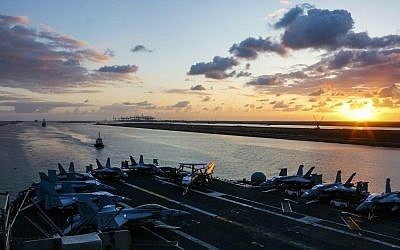 In this May 9, 2019 photo released by the US Navy, the Nimitz-class aircraft carrier USS Abraham Lincoln transits the Suez Canal in Egypt. (Mass Communication Specialist Seaman Dan Snow, US Navy via AP)