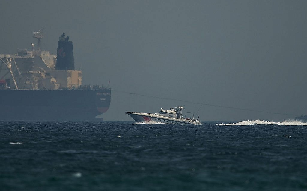 An Emirati coast guard vessel passes an oil tanker off the coast of Fujairah, United Arab Emirates, on May 13, 2019. (AP Photo/Jon Gambrell)