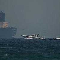 An Emirati coast guard vessel passes an oil tanker off the coast of Fujairah, United Arab Emirates, on May 13, 2019. (AP Photo/Jon Gambrell)