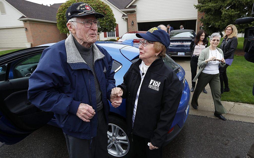 Doug Harvey, 95, and Holocaust survivor Sophie Tajch Klisman, 89, right, greet each other in Commerce Township, Michigan, May 13, 2019. (AP Photo/Paul Sancya)