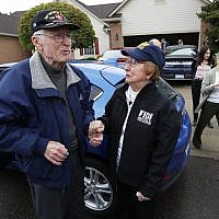 Doug Harvey, 95, and Holocaust survivor Sophie Tajch Klisman, 89, right, greet each other in Commerce Township, Michigan, May 13, 2019. (AP Photo/Paul Sancya)
