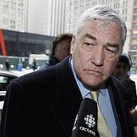 In this Jan. 13, 2011 file photo, Conrad Black arrives at the federal building in Chicago. President Donald Trump has granted a full pardon to Black, a former newspaper publisher who has written a flattering political biography of Trump. Black's media empire once included the Chicago Sun-Times and The Daily Telegraph of London. (AP Photo/Charles Rex Arbogast)