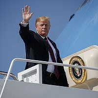 President Donald Trump waves as he boards Air Force One for a trip to New York to attend a fundraiser, Thursday, May 16, 2019, at Andrews Air Force Base, Md. (AP Photo/Evan Vucci)