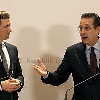 In this December 4, 2018 file photo, Austria's Chancellor Sebastian Kurz and Austrian Vice Chancellor Heinz-Christian Strache, from left, hold a joint press conference after one year government in Austria at the Hofburg palace in Vienna, Austria. (AP Photo/Ronald Zak)
