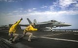 In this May 16, 2019 photo released by the US Navy, Lt. Nicholas Miller, from Spring, Texas, and Lt. Sean Ryan, from Gautier, Miss., launch an F-18 Super Hornet from the deck of the USS Abraham Lincoln aircraft carrier in the Arabian Sea. (Mass Communication Specialist 3rd Class Jeff Sherman, US Navy via AP)