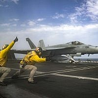 In this Thursday, May 16, 2019 photo released by the US Navy, Lt. Nicholas Miller, from Spring, Texas, and Lt. Sean Ryan, from Gautier, Miss., launch an F-18 Super Hornet from the deck of the USS Abraham Lincoln aircraft carrier in the Arabian Sea. (Mass Communication Specialist 3rd Class Jeff Sherman, US Navy via AP)