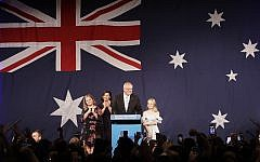 Australian Prime Minister Scott Morrison, second right, arrives on stage to speak to party supporters flanked by his wife, Jenny, and daughters Lily, and Abbey, left, after his opponent concedes defeat in the federal election in Sydney, Australia, Sunday, May 19, 2019. (AP Photo/Rick Rycroft)