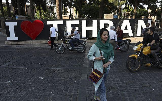 Pedestrians and drivers make their way through a street in downtown Tehran, Iran, May 18, 2019. (Vahid Salemi/AP)