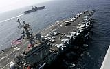 In this May 17, 2019, photo released by the US Navy, the USS Abraham Lincoln sails in the Arabian Sea near the amphibious assault ship USS Kearsarge. (Mass Communication Specialist 1st Class Brian M. Wilbur, US Navy via AP)