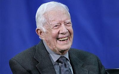 In this photo from September 18, 2018, former US president Jimmy Carter answers questions from students during his annual town hall with Emory University freshman in the campus gym in Atlanta. (Curtis Compton/Atlanta Journal-Constitution via AP, File)/