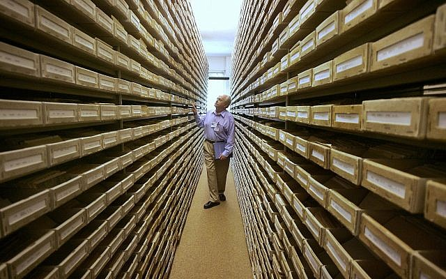 Gary Mokotoff, a Jewish genealogist from New Jersey, takes a look at name registers at the International Tracing Service in Bad Arolsen, central Germany, May 8, 200. (Michael Probst/AP)