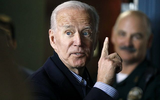 In this May 13, 2019, photo, former US vice president and Democratic presidential candidate Joe Biden interacts with a supporter during a campaign stop at the Community Oven restaurant in Hampton, New Hampshire. (AP Photo/Michael Dwyer, File)