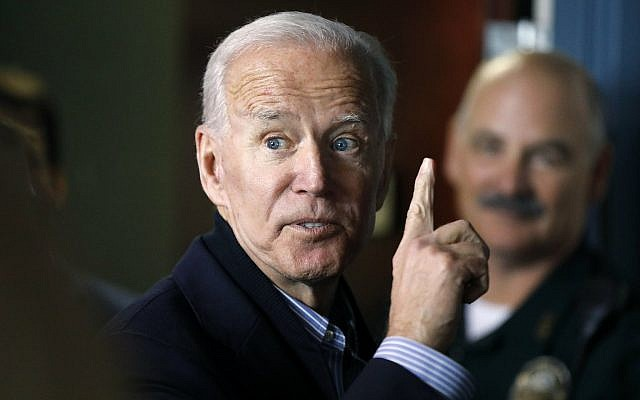 In this May 13, 2019, photo, former US vice president and Democratic presidential candidate Joe Biden speaks to a supporter during a campaign stop at the Community Oven restaurant in Hampton, New Hampshire. (AP Photo/Michael Dwyer, File)