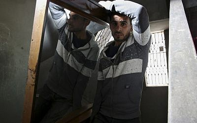 In this April 21, 2019 photo, Palestinian groom Yehiya Taleb, center, move a mirror, part of his wedding furniture, to his apartment in Shati refugee camp, Gaza City. (AP Photo/Adel Hana)