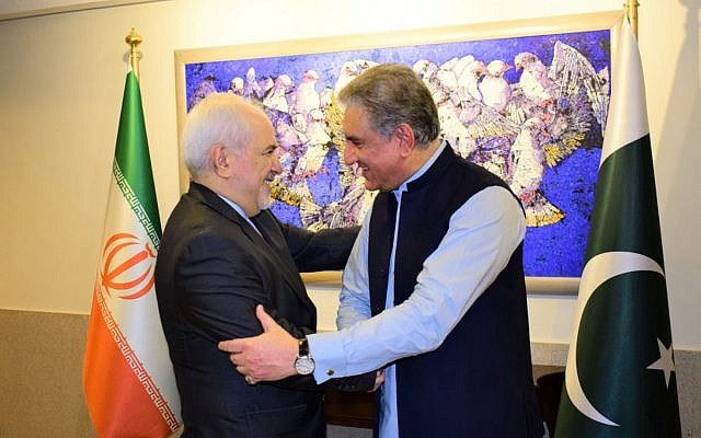 In this photo released by the Foreign Office, Pakistani Foreign Minister Shah Mehmood Qureshi, right, shakes hands with Iranian Foreign Minister Mohammad Javad Zarif at the Foreign Ministry in Islamabad, Pakistan, Friday, May 24, 2019. (Pakistan Foreign Office via AP)