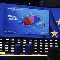A projection of the composition of the next European Parliament on a large screen in the press room at the European Parliament in Brussels on May 27, 2019. (AP Photo/Olivier Matthys)