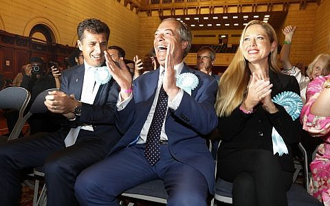 Brexit Party leader Nigel Farage reacts as results are announced at the counting center for the European Elections for the South East England region, in Southampton, England on May 26, 2019. (AP Photo/Alastair Grant)