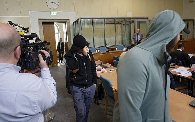 In this May 24, 2019 file photo, two defendants of a self-styled 'Sharia police' arrive in a courtroom in Wuppertal, Germany. (Henning Kaiser/dpa via AP)
