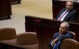 Prime Minister Benjamin Netanyahu (front) and former Defense Minister Avigdor Liberman sit in the Knesset, May 23, 2016. (AP Photo/Sebastian Scheiner, File)