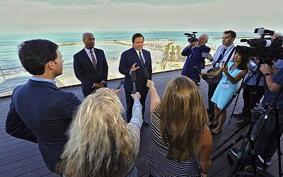 With the Mediterranean Sea as a backdrop, Florida Gov. Ron DeSantis speaks to reporters on May 27, 2019, ahead of the first full day of a Florida trade delegation trip to Israel. (Jeff Schweers/Tallahassee Democrat via AP)