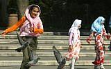 ILLUSTRATIVE: Girls wearing Islamic headscarves play in a park in  Istanbul, Turkey, July 22, 2004 (AP Photo/Osman Orsal)
