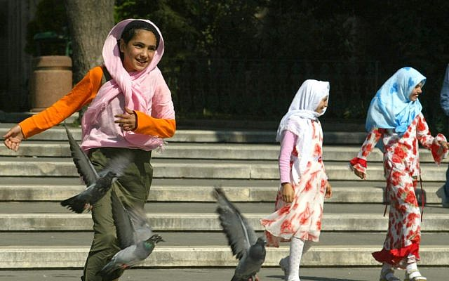 ILLUSTRATIVE: Girls wearing Islamic headscarves play in a park in  Istanbul, Turkey, July 22, 2004 (AP Photo/Osman Orsal)