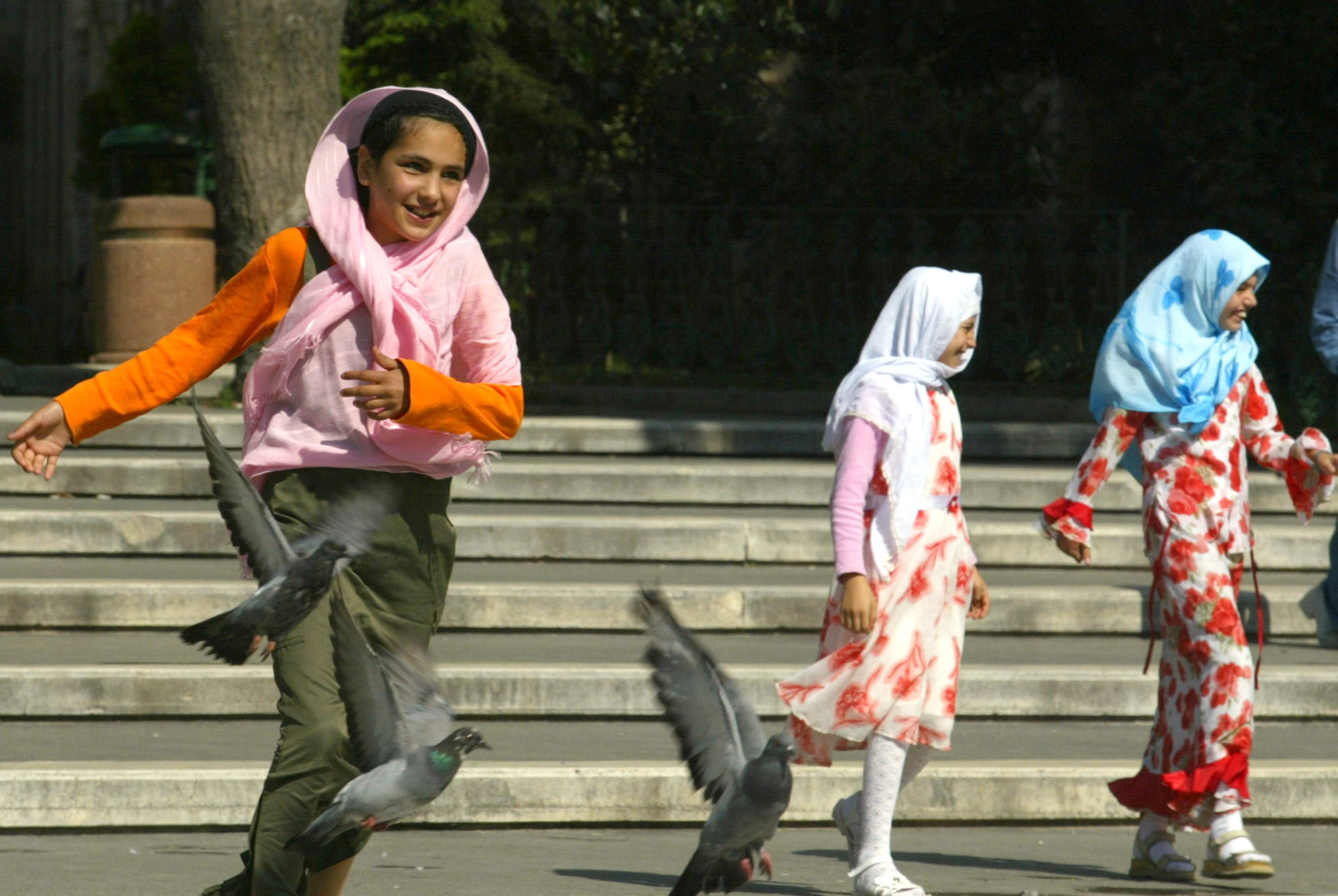 ILLUSTRATIVE Girls wearing Islamic headscarves play in a park in Istanbul Turkey