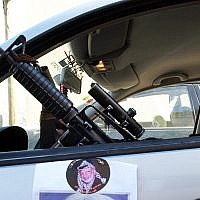 Zakaria Zubeidi, then the local commander of Fatah's terrorist wing, the Al-Aqsa Martyrs Brigades, sits in a car decorated with a poster of former Palestinian leader Yasser Arafat, in the northern West Bank town of Jenin, December 2, 2004. (AP Photo/Mohammed Ballas)