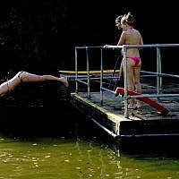 Ilustrative. A woman dives intoa pond on Hampstead Heath in London, September 28, 2011. (Matt Dunham/AP)