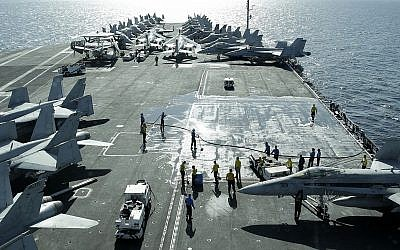 View from the bridge of the Nimitz-class aircraft carrier USS Abraham Lincoln (CVN 72) shows US jets parked on the flight deck in the Strait of Hormuz off the coast of Iran, February 15, 2012. (AP/Hassan Ammar)