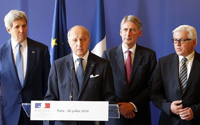 French Foreign Minister, Laurent Fabius, center, delivers his speech during a press conference flanked with, from left, U.S. Secretary of State, John Kerry, British Foreign Secretary, Philip Hammond, and German Foreign Minister, Frank-Walter Steinmeier after a meeting at Quai d'Orsay in Paris, France on, July 26, 2014 to press for a cease-fire in Gaza. (AP Photo/Francois Mori )