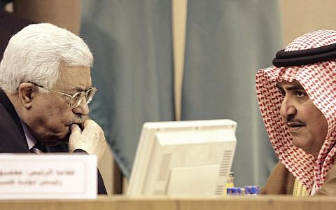 Palestinian Authority President Mahmoud Abbas, left, listens to Bahrain's Foreign Minister Khalid bin Ahmed al-Khalifa during an emergency Arab League session in Cairo, Egypt, May 28, 2016. (AP Photo/Amr Nabil)