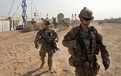 US Army soldiers move through Qayara West Coalition base in Qayara, some 50 kilometers south of Mosul, Iraq,  November 9, 2016. (AP/Marko Drobnjakovic)