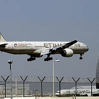 In this May 4, 2014 file photo, an Etihad Airways plane prepares to land at the Abu Dhabi airport in the United Arab Emirates (AP Photo/Kamran Jebreili, File)