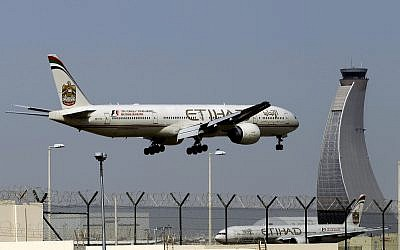 In this May 4, 2014, photo, an Etihad Airways plane prepares to land at the Abu Dhabi airport in the United Arab Emirates (AP Photo/Kamran Jebreili)