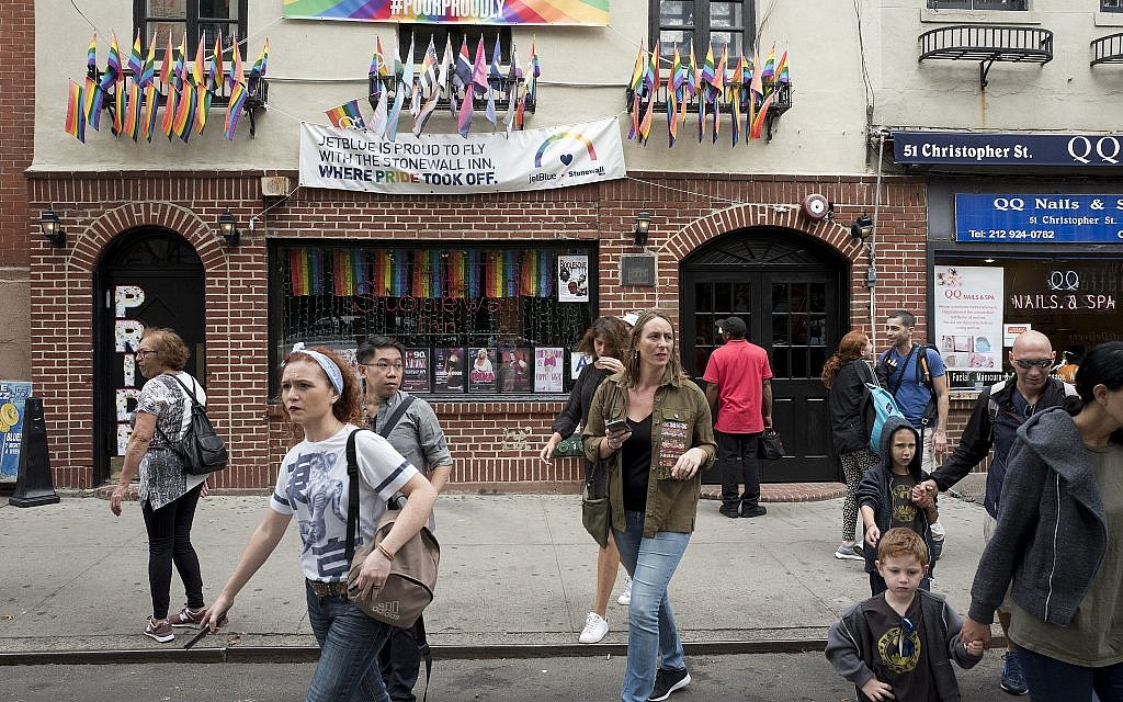 Illustrative: People pass the Stonewall Inn, Wednesday, October 11, 2017, in New York. (AP Photo/Mark Lennihan)