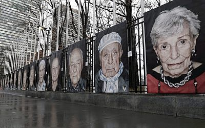 Illustrative: Larger-than-life portraits by Italian photographer Luigi Toscano line a fence bordering United Nations headquarters, January 23, 2018, in New York. (AP Photo/Kathy Willens)