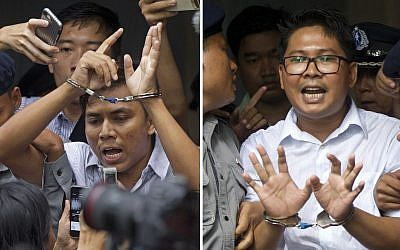 Reuters journalists Kyaw Soe Oo, left, and Wa Lone, are handcuffed as they are escorted by police out of the court Monday, Sept. 3, 2018, in Yangon, Myanmar after being sentenced to seven years in prison. (AP /Thein Zaw)