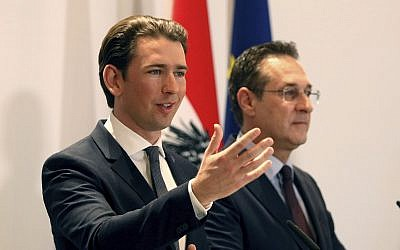 Austria's Chancellor Sebastian Kurz and Austrian Vice Chancellor Heinz-Christian Strache, from left, hold a joint press conference after one year government in Austria in Vienna, Austria, December 4, 2018. (AP Photo/Ronald Zak)