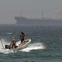 Illustrative: Fishermen in waters off Fujairah, United Arab Emirates, near the Strait of Hormuz, on May 30, 2012. (AP Photo/Kamran Jebreili, File)