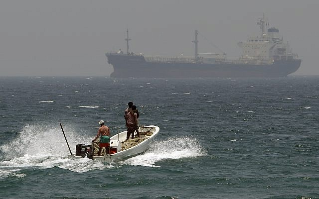 Illustrative: Fishermen in waters off Fujairah, United Arab Emirates, near the Strait of Hormuz, on May 30, 2012. (AP Photo/Kamran Jebreili, File)