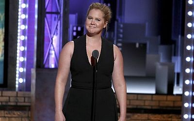 "In this file photo from June 10, 2018, Amy Schumer introduces a performance by the cast of ""My Fair Lady"" at the 72nd annual Tony Awards at Radio City Music Hall in New York. (Photo by Michael Zorn/Invision/AP, File)"