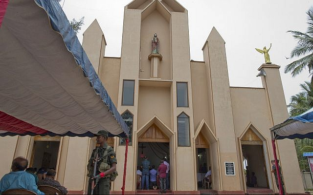 A soldier stands guard during a Catholic Mass outside St. Joseph's church in Thannamunai, Sri Lanka, April 30, 2019. (AP/Gemunu Amarasinghe)