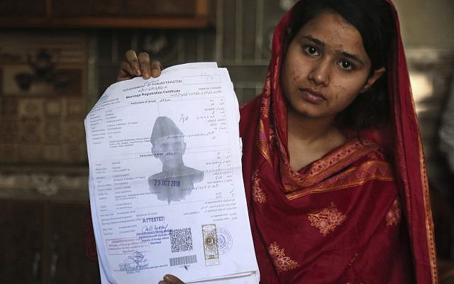 Mahek Liaqat, a Pakistani Christian girl lured into a marriage with a Chinese national, shows her marriage certificate in Gujranwala, Pakistan, April 14, 2019. (AP/K.M. Chaudary)