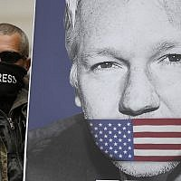 A supporter of Julian Assange, with a poster of the WikiLeaks founder, joins other protesters to block a major road in front of Westminster Magistrates Court in London, Thursday, May 2, 2019. (AP/Frank Augstein)